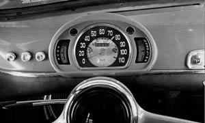 Indicador de temperatura con aguja y luz de alerta.